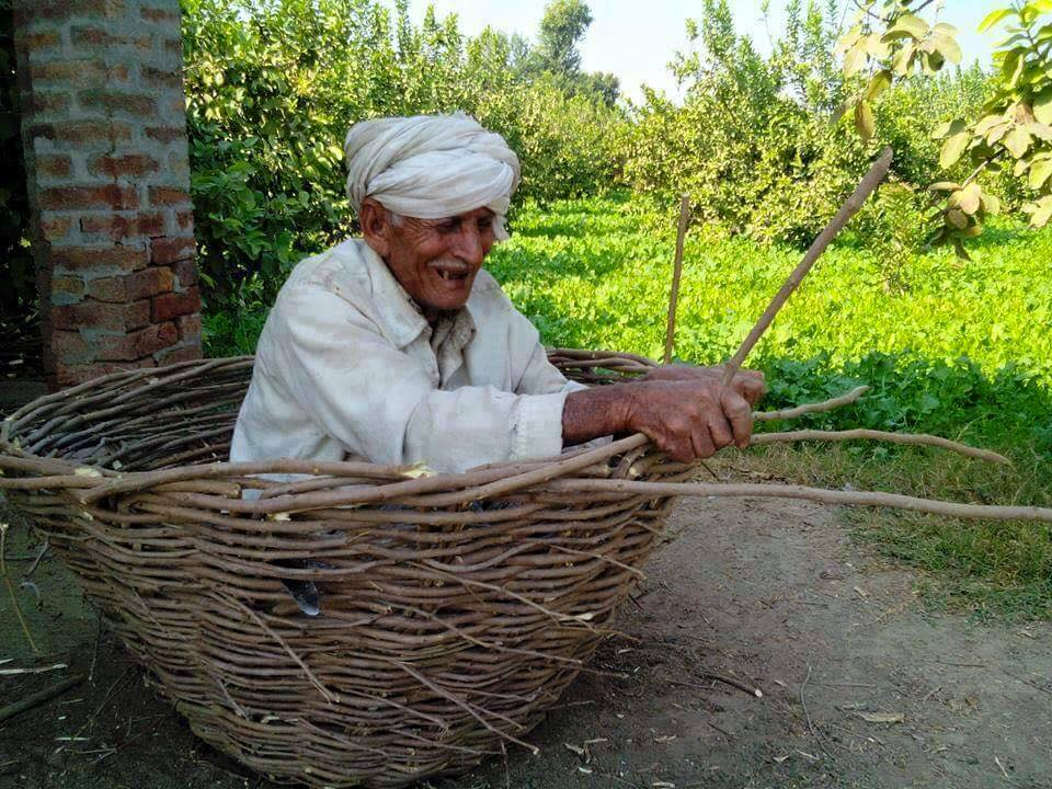 Name:  old man in basket punjab.jpg