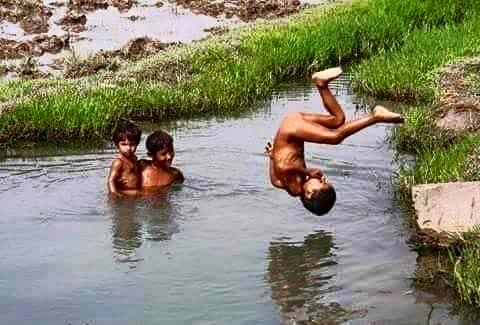 Name:  punjab kids playing in pond.jpg