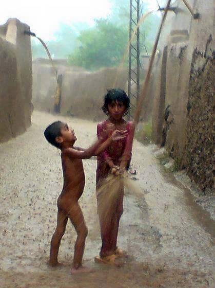 Name:  punjab kids playing in rain.jpg